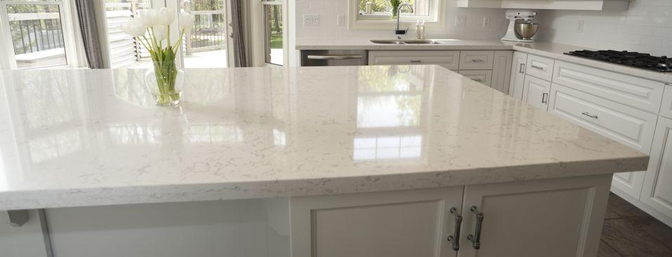 Bright White & Unstoppable Kitchen Design by Progressive Countertop!