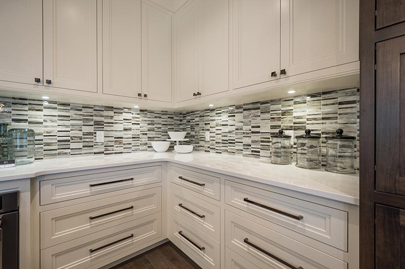 Whitehall by Cambria from Progressive Countertop with a  glass tile back splash